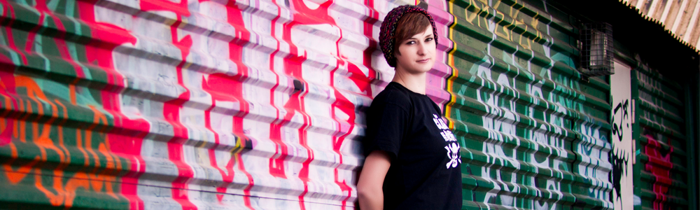 Support into employment image of young woman stood against a graffiti background