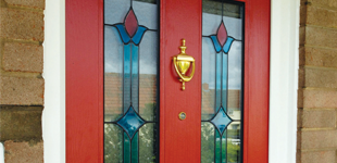 A closed red front door