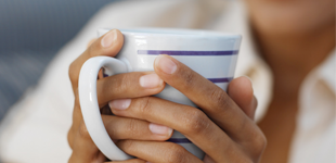 A woman holding a mug with both hands